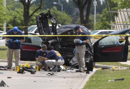 Local police and FBI investigators collect evidence and survey the scene where two gunmen were shot dead, after their bodies were removed in Garland, Texas May 4, 2015. REUTERS/Laura Buckman